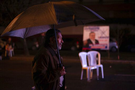 A supporter waits for Alejandro Giammattei, presidential candidate of the Vamos party, at his campaign headquarters during general elections in Guatemala City, Sunday, June 16, 2019.