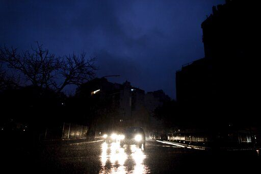 "Cars drive through an unlit street during a blackout in Buenos Aires, Argentina, Sunday, June. 16, 2019. A massive blackout left tens of millions of people without electricity in Argentina, Uruguay and Paraguay on Sunday in what the Argentine president called an ""unprecedented� failure in the countries' power grid."
