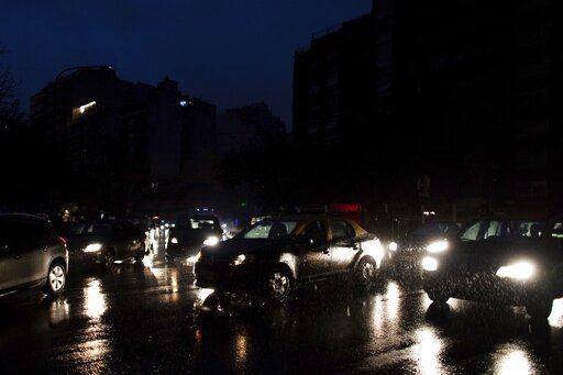 "Cars drive through an unlit street during a blackout in Buenos Aires, Argentina, Sunday, June 16, 2019. A massive blackout left tens of millions of people without electricity in Argentina, Uruguay and Paraguay on Sunday in what the Argentine president called an ""unprecedented� failure in the countries' power grid."