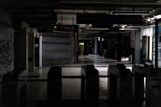 Hallways of Buenos Aires's subway are lit only by emergency lights during a blackout, in Buenos Aires, Argentina, Sunday, June 16, 2019. Argentina and Uruguay were working frantically to return power on Sunday, after a massive power failure left large swaths of the South American countries in the dark.
