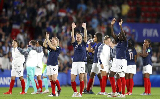 France players celebrate at the end of the Women's World Cup Group A soccer match between Nigeria and France at the Roazhon Park in Rennes, France, Monday, June 17, 2019. France beat Nigeria 1-0.
