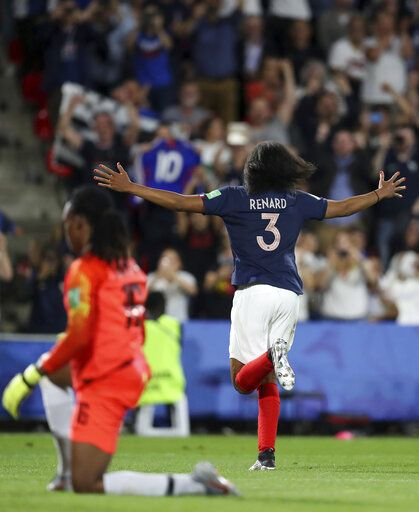 France's Wendie Renard, right, celebrates after scoring the opening goal against Nigeria goalkeeper Chiamaka Nnadozie during the Women's World Cup Group A soccer match between Nigeria and France at the Roazhon Park in Rennes, France, Monday, June 17, 2019.