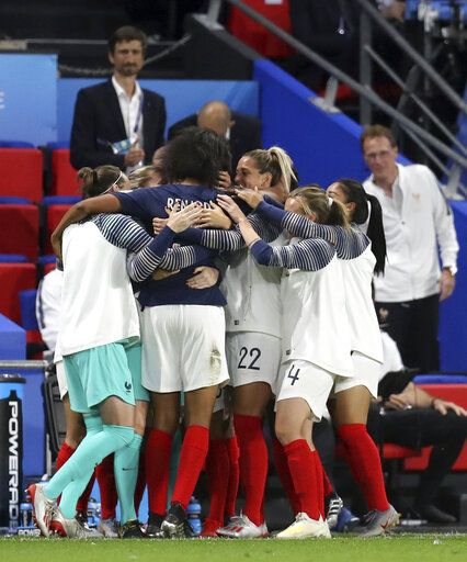 France's Wendie Renard, second from left, celebrates with teammates after scoring the opening goal during the Women's World Cup Group A soccer match between Nigeria and France at the Roazhon Park in Rennes, France, Monday, June 17, 2019.
