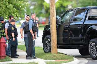 Police investigate a shooting Tuesday at Berkshire Circle and Wakefield Drive in Carpentersville.