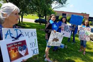 Mary Becker, left, of Crystal Lake and other residents demonstrated outside the McHenry County Courthouse Tuesday to keep AJ Freund's memory alive and to call for improvements at the Department of Children and Family Services.