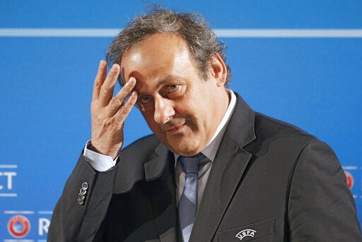 FILE - In this Feb.22, 2014 file photo, UEFA President Michel Platini arrives at a press conference, one day prior to the UEFA EURO 2016 qualifying draw in Nice, southeastern France. Former UEFA president Michel Platini has been arrested Tuesday June 18, 2019 over the awarding of the 2022 World Cup.