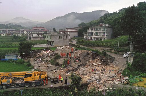 In this photo released by Xinhua News Agency, rescue workers search for trapped people at a collapsed building after an earthquake in Shuanghe Town in Changning County of Yibin City, southwest China's Sichuan Province, Tuesday, June 18, 2019. The strong earthquake that hit Sichuan province in southern China late Monday night. (Zeng Lang/Xinhua via AP) NO SALES