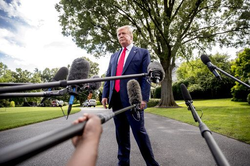 President Donald Trump takes a question from a reporter before boarding Marine One on the South Lawn of the White House in Washington, Tuesday, June 18, 2019, for a short trip to Andrews Air Force Base, Md., and then on to Orlando, Fla. for a rally.