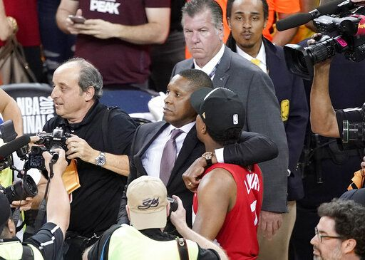FILE - This Thursday, June 13, 2019, file photo, Toronto Raptors general manager Masai Ujiri, center left, walks with guard Kyle Lowry after the Raptors defeated the Golden State Warriors in Game 6 of the NBA Finals in Oakland, Calif. An attorney for a deputy involved in an altercation with Ujiri as he tried to join his team on the court to celebrate their NBA championship, said his client suffered a concussion and is on medical leave. Attorney David Mastagni said Tuesday, June 18, 2019, the 20-year-veteran of the Alameda County Sheriff's Office has a jaw injury and is considering filing a lawsuit.