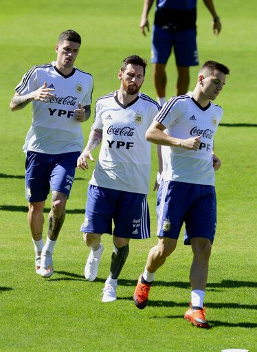 Argentina's Lionel Messi, center, warms up during a practice session of the national soccer team in Belo Horizonte, Brazil, Tuesday, June 18, 2019. Argentina will face Paraguay tomorrow in a Copa America Group B soccer match.