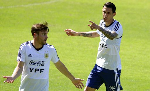 Argentina's Angel Di Maria, right, talks with teammate Nicolas Tagliafico during a practice session of the national soccer team in Belo Horizonte, Brazil, Tuesday, June 18, 2019. Argentina will face Paraguay tomorrow in a Copa America Group B soccer match.