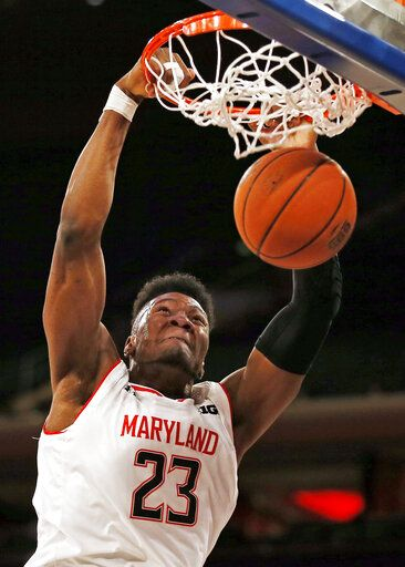 FILE - In this Jan. 26, 2019, file photo, Maryland forward Bruno Fernando (23) dunks the ball during the first half of an NCAA college basketball game against Illinois, in New York. Fernando is an NBA draft first-round prospect who measured well (6-10 height, 7-3 wingspan) at the combine after averaging a double-double (13.6 points, 10.6 rebounds).