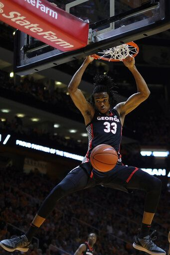 FILE - In this Jan. 5, 2019, file photo, Georgia forward Nicolas Claxton (33) dunks the ball in the first half of an NCAA college basketball game against Tennessee, in Knoxville, Tenn. Claxton is an NBA draft first-round prospect who thrived last season (13.0 points, 8.6 rebounds) while measuring at nearly 7-0 with a nearly 7-3 wingspan.
