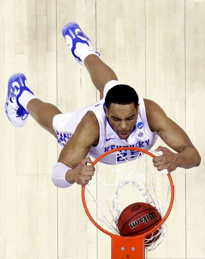 FILE - In this March 31, 2019, file photo, Kentucky's PJ Washington dunks the ball during the second half of the Midwest Regional final game against Auburn in the NCAA men's college basketball tournament in Kansas City, Mo. Washington brings length and athleticism inside along with the ability to step out of the paint, which could have him go late in the lottery at the NBA draft.