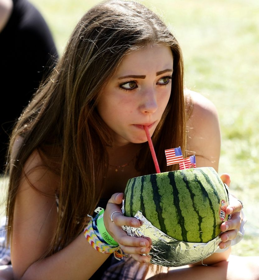 Madeline Walbridge of Naperville cools off sipping watermelon juice during last year's Ribfest in Naperville.