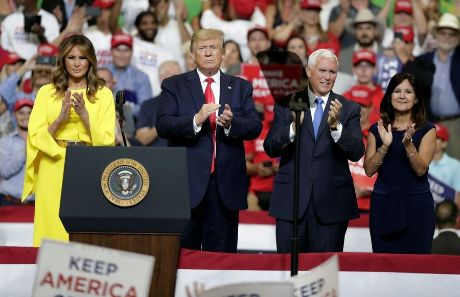 First lady Melania Trump, President Donald Trump, Vice President Mike Pence and Karen Pence greet supporters at a rally where Trump formally announced his 2020 re-election bid Tuesday, June 18, 2019, in Orlando, Fla.
