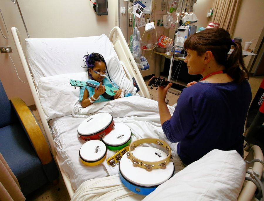 Snow City Arts brings one-on-one, learning opportunities to the rooms of pediatric patients at its partner hospitals.