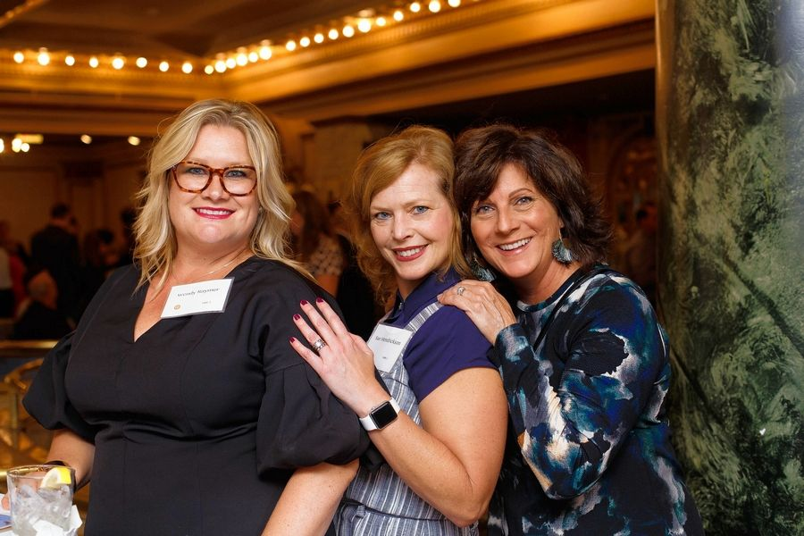 Wendy Raymer and Sue Hendrickson of Chicago and Kim Paschal of St. Charles support a fundraiser gala for Snow City Arts.