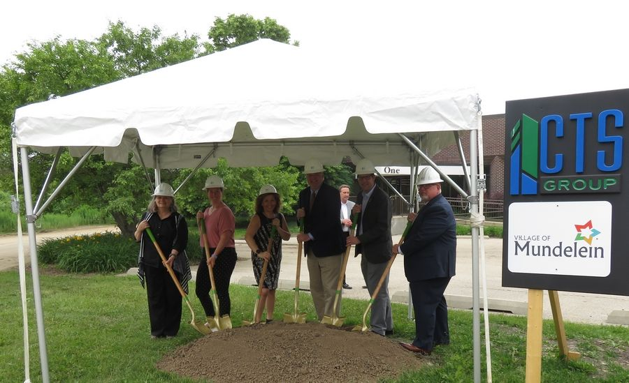 Mundelein Board of Trustees gather to mark the official groundbreaking for the Village of Mundelein's new Public Works and Engineering facility.  Pictured left to right: Robin Meier, Kara Lambert, Dawn Abernathy, Mayor Steve Lentz, Erich Schwenk, and Ray Semple. Dawn Jenich