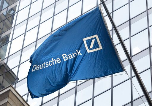 FILE - In this Oct. 7, 2016, file photo a flag for Deutsche Bank flies outside the German bank's New York offices on Wall Street. The FBI has reached out to a lawyer for a former Deutsche Bank employee who complained that the bank was ignoring suspicious transactions, including some involving Jared Kushner's family real estate company.