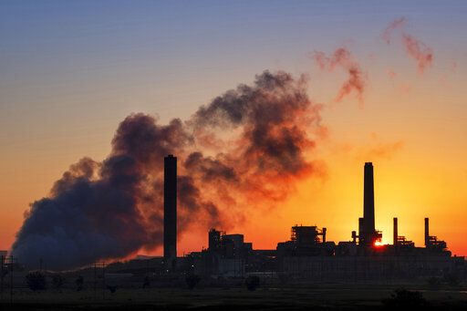 FILE - In this July 27, 2018, file photo, the Dave Johnson coal-fired power plant is silhouetted against the morning sun in Glenrock, Wyo. The Trump administration announced on Wednesday, June 19, 2019, that it has rolled back a landmark Obama-era effort targeting coal-fired power plants and their climate-damaging pollution.