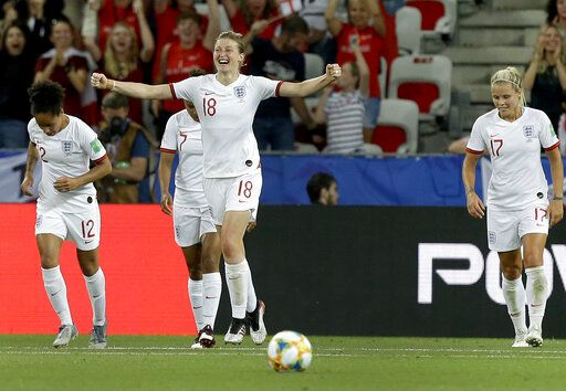 England's Ellen White, front, celebrates after scoring her side's second goal during the Women's World Cup Group D soccer match between Japan and England at the Stade de Nice in Nice, France, Wednesday, June 19, 2019.
