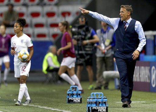 England head coach Philip Neville, right, gestures during the Women's World Cup Group D soccer match between Japan and England at the Stade de Nice in Nice, France, Wednesday, June 19, 2019.