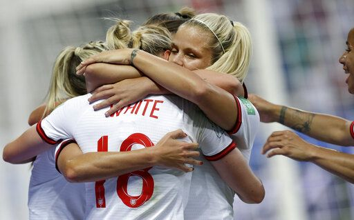 England's scorer Ellen White, front, and her teammates celebrate the opening goal during the Women's World Cup Group D soccer match between Japan and England at the Stade de Nice in Nice, France, Wednesday, June 19, 2019.
