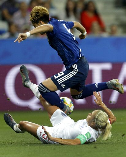 Japan's Yuika Sugasawa, top, and England's Steph Houghton, bottom, challenge for the ball during the Women's World Cup Group D soccer match between Japan and England at the Stade de Nice in Nice, France, Wednesday, June 19, 2019.