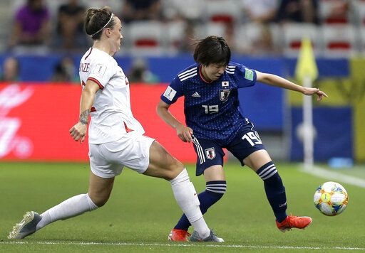 England's Lucy Bronze, left, and Japan's Jun Endo, right, challenge for the ball during the Women's World Cup Group D soccer match between Japan and England at the Stade de Nice in Nice, France, Wednesday, June 19, 2019.
