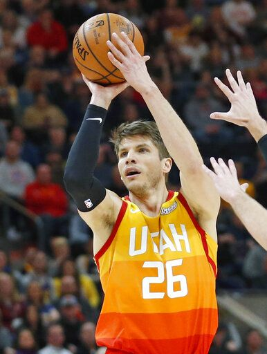 FILE - In this Jan. 14, 2019, file photo, Utah Jazz guard Kyle Korver (26) looks to shoot against the Detroit Pistons during the second half of an NBA basketball game, in Salt Lake City. A person with knowledge of the decision says the Memphis Grizzlies have traded veteran point guard Mike Conley, who has played the most games in franchise history, to the Utah Jazz. The person says the Grizzlies swapped Conley for Jae Crowder, Kyle Korver and Grayson Allen. The person spoke to The Associated Press Wednesday, June 19, 2019, on condition of anonymity because neither Memphis nor Utah has announced the trade
