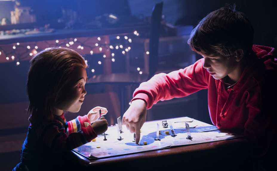 "Chucky, left, plays with new owner Andy (Gabriel Bateman) in ""Child's Play."""