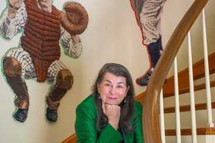 "Filmmaker Aviva Kempner's Washington, D.C., home displays hook rug art of baseball players including catcher Moe Berg, the subject of her new documentary, ""The Spy Behind Home Plate."""