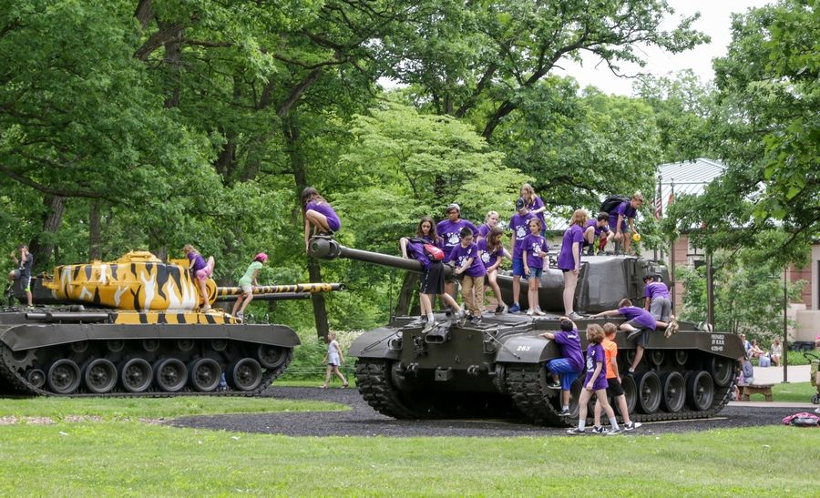 Children climb on the tanks outside the First Division Museum at Cantigny Park.
