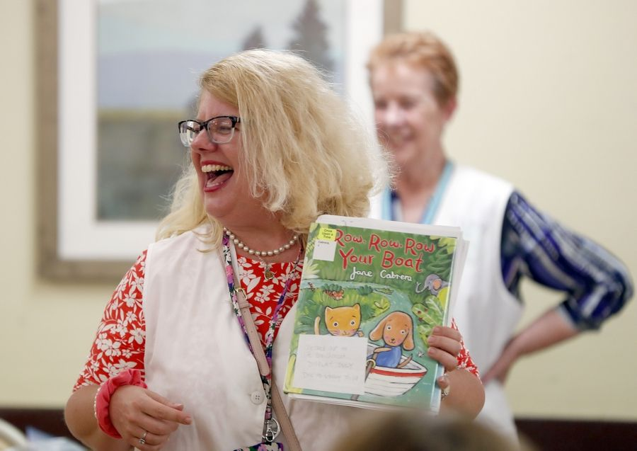 Glenna Godinsky from Gail Borden Public Library in Elgin read last week to residents at River View Rehab Center in Elgin. Elgin was welcomed into the Dementia Friendly America network last week thanks to an effort lead by library staff members.