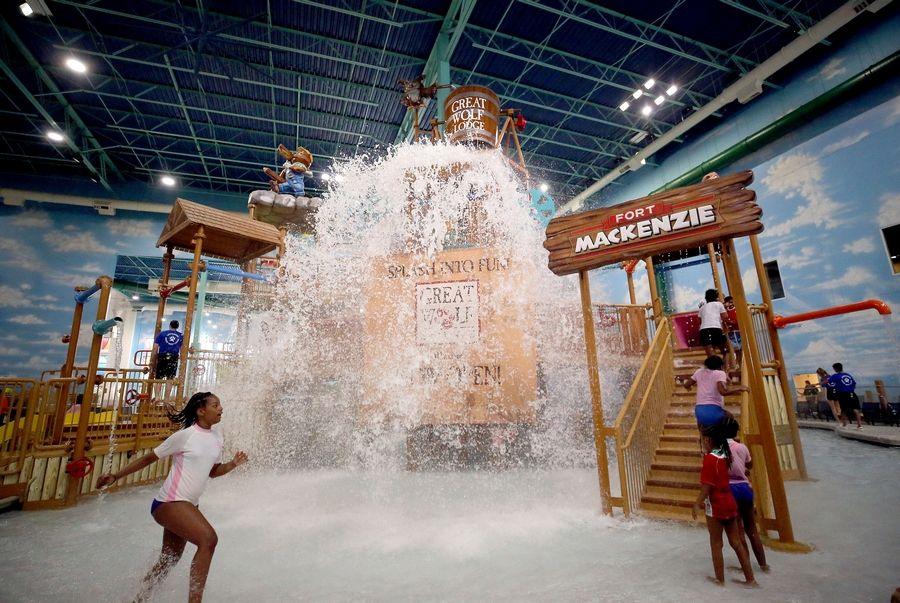 Kids play in the water park during the grand opening ceremony at Great Wolf Lodge in Gurnee last June.