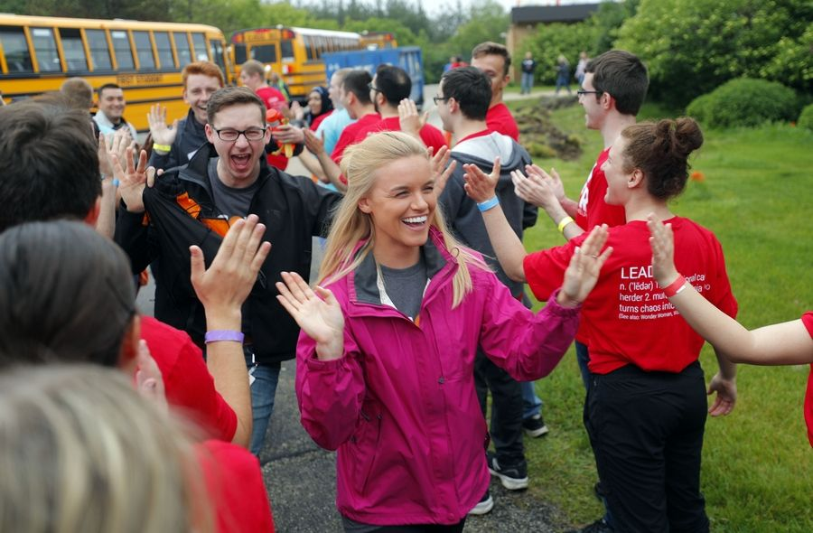 Volunteers are greeted by team leaders as they arrived Thursday at Gavin South Middle School in Ingleside to give the school an indoor and outdoor makeover.