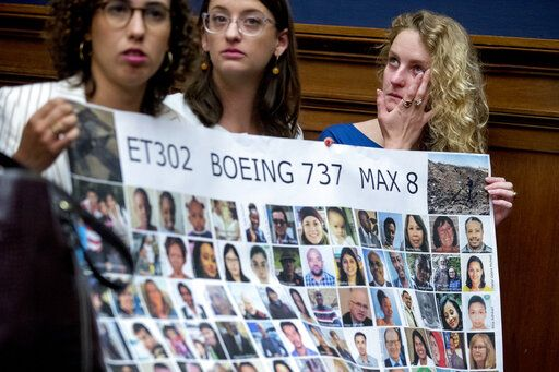 Deveney Williams, right, wipes a tear from her eye as she and Diana Sotomayor, left, and Hayley Freedman, center, all friends of Samya Rose Stumo, hold up a sign depicting those lost in Ethiopian Airlines Flight 302 during a House Committee on Transportation and Infrastructure hearing on the status of the Boeing 737 MAX on Capitol Hill in Washington, Wednesday, June 19, 2019. Stumo was killed in the plane crash.