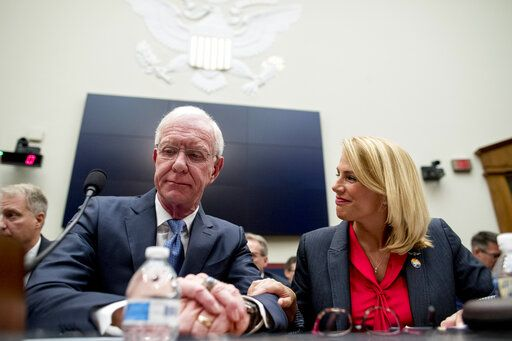 "Sara Nelson with the Association of Flight Attendants-CWA, right, speaks with Captain Chesley ""Sully"" Sullenberger left, before a House Committee on Transportation and Infrastructure hearing on the status of the Boeing 737 MAX on Capitol Hill in Washington, Wednesday, June 19, 2019."