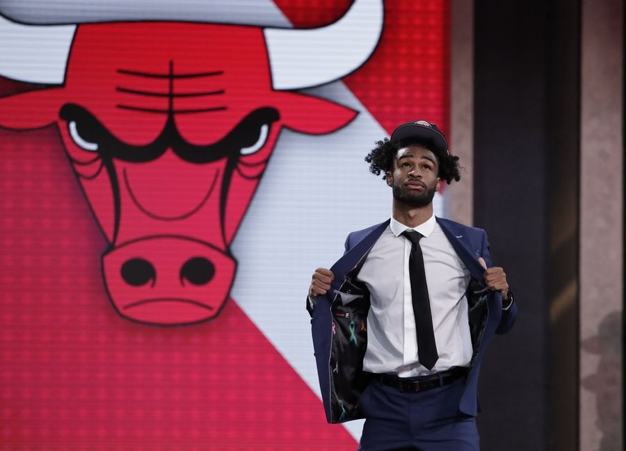 North Carolina's Coby White walks onstage after the Chicago Bulls selected him as the seventh overall in the NBA basketball draft Thursday, June 20, 2019, in New York.