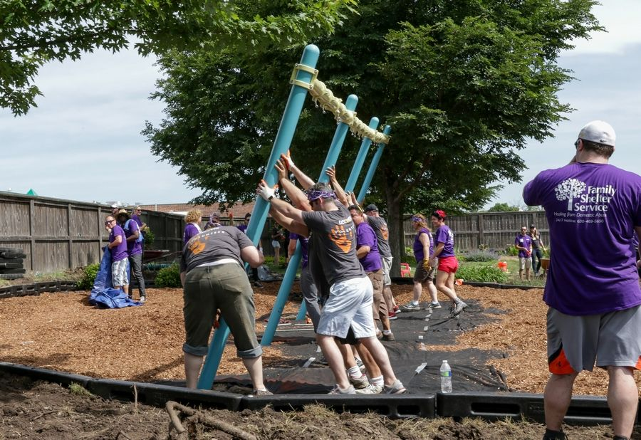 More than 200 volunteers help build a playground Wednesday for the domestic violence shelter run by Family Shelter Service of Metropolitan Family Services DuPage.