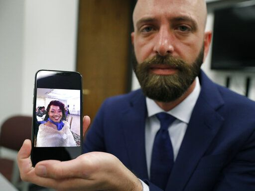 In this Wednesday, June 19, 2019 photo, Eric Ridenhour poses with a photo he took of his fiancee Kiersten Smith after giving an interview in Dallas. Smith was killed in the June 9 crane collapse in downtown Dallas.