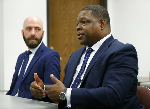 In this Wednesday, June 19, 2019 photo, attorney Jonathan Cox responds to a question during an interview as Eric Ridenhour, left, listens in Dallas, Wednesday, June 19, 2019. Ridenhour's fiancee was killed in the June 9 crane collapse in downtown Dallas.