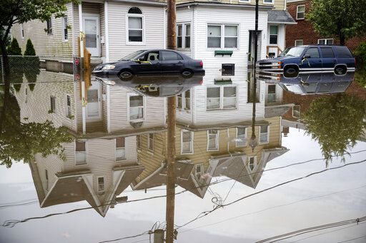 Floodwaters partially submerge vehicles on Broadway in Westville, N.J. Thursday, June 20, 2019. Severe storms containing heavy rains and strong winds spurred flooding across southern New Jersey, disrupting travel and damaging some property.
