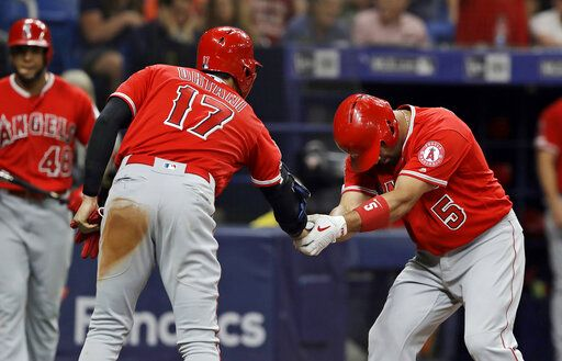 Los Angeles Angels' Albert Pujols (5) bows as he shakes hands with Shohei Ohtani (17), of Japan, after Pujols hit a two-run home run off Tampa Bay Rays' Ryan Yarbrough during the fifth inning of a baseball game Thursday, June 13, 2019, in St. Petersburg, Fla.