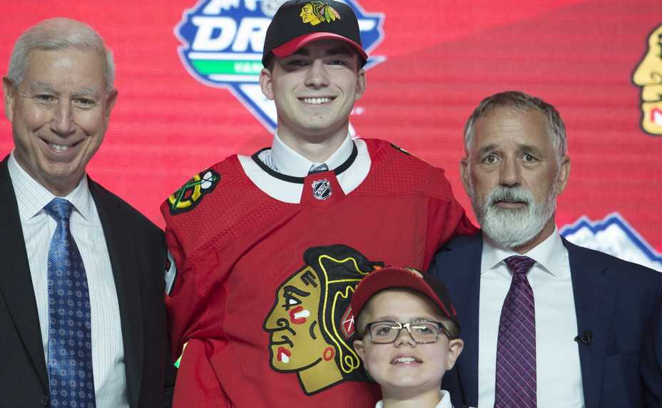 e49c152d3672 Chicago Blackhawks pick Kirby Dach, center, poses during the first round of  the NHL