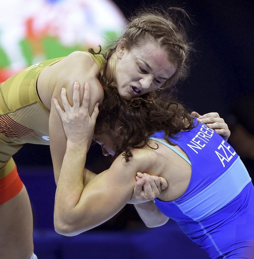 USA wrestler Forrest Molinari, in yellow, is set to visit a camp June 29 in Naperville that organizers are setting up to interest more girls in the sport.