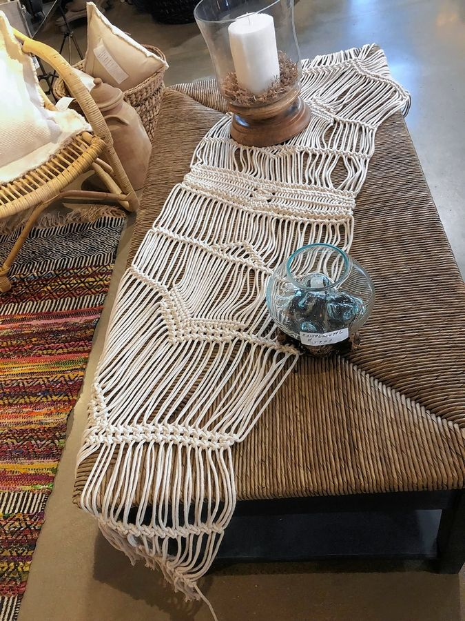 Macrame table runners and plant hangers at Lurvey's hearken back to the days of rope hammocks.