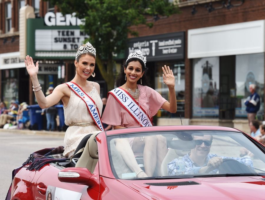 Mrs. America Nicole Cook and Miss Illinois Alexandra Plotz ride in the 70th annual Swedish Days parade in Geneva Sunday.
