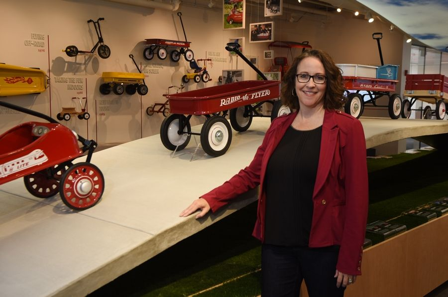 Amy Bastuga, chief people officer of Radio Flyer in Chicago.  At right, below, wagons on display at the company.